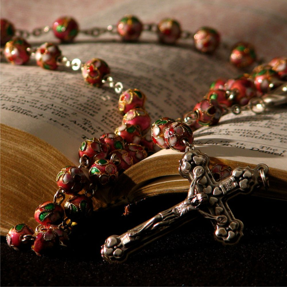 Rosary over Bible